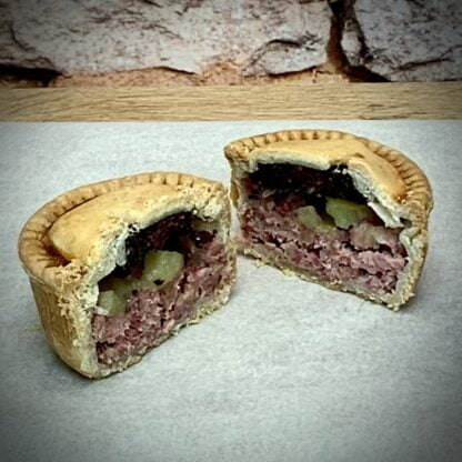 Thornton's Bakehouse & Butchers Pork Pie topped with Apple & Black Pudding